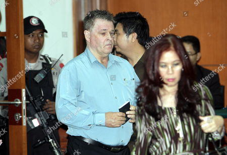 Australian Bali Bombing Victim Peter Hughes (c) Arrives Inside the Court Room to Gives His Testimony During Indonesian Terrorists Suspect Umar Patek's Trial in Jakarta Indonesia on 05 April 2012 Umar Patek is Accused of Mixing Explosive Materials Used in the 2002 Bali Nightclub Attacks That Killed 202 People Patek Faces Six Counts Including Premeditated Murder Bomb-making and Illegal Firearms Possession and Could Face the Death Penalty if Found Guilty Three Australians Are Set to Give Their Testimony During the Hearing Indonesia Jakarta