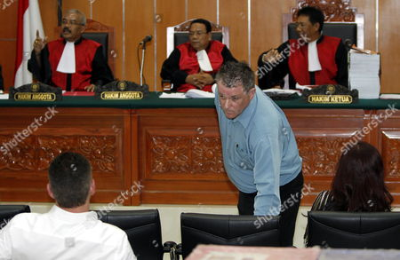 Australian Bali Bombing Victim Peter Hughes (c) Takes His Seat As He Delivers His Testimony During Indonesian Terror Suspect Umar Patek's Trial in Jakarta Indonesia 05 April 2012 Umar Patek is Accused of Mixing Explosive Materials Used in the 2002 Bali Nightclub Attacks That Killed 202 People Patek Faces Six Counts Including Premeditated Murder Bomb-making and Illegal Firearms Possession and Could Face the Death Penalty if Found Guilty Indonesia Jakarta