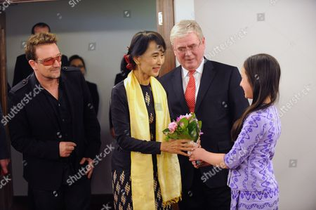 Stock Image of Irish Singer of U2 Rock Group Bono (l) and Myanmar Pro-democracy Leader Aung San Suu Kyi (c) the Irish Tánaiste and Minister For Foreign Affairs & Trade Eamon Gilmore (2-r) Meet with Sophia Kelly (r) a Member of the Burmese Irish Community at Dublin Airport 18 June 2012 Suu Kyi is in Ireland For a Six Hour Visit where She Will Meet the Irish President Receive the Freedom of the City of Dublin and Celebrate Her Birthday Ireland Dublin