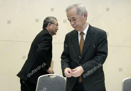 Tokyo Electric Power Company Incorporated (tepco) President Toshio Nishizawa (l) and Naomi Hirose (r) Successor to Nishizawa Leave Their Seats After Concluding a News Conference Announcing Its Earning Result of the Fiscal Year Ending and the Introduction of a New Leadership in Tokyo Japan 14 May 2012 New Leaders of the Tepco Will Be Officially Approved at the Shareholders' Meeting in June Japan Tokyo