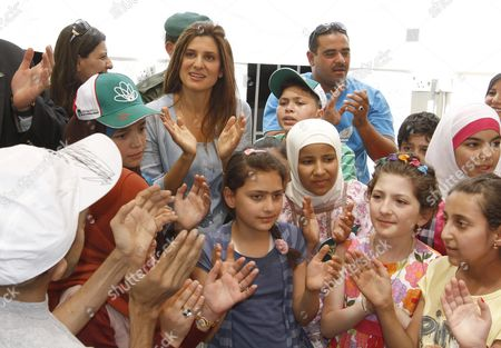 Jordan's Princess Dina Mired (l) Director General of the King Hussein Cancer Foundation (khcf) Celebrates with Child Cancer Patients During the Summer Camp Opening at the King Hussein Cancer Center in Amman Jordan on 01 July 2012 Jordan Amman