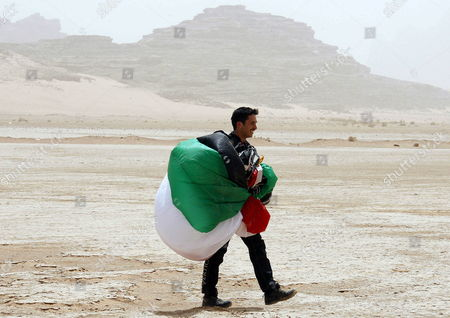 Stock Image of Jordanian Prince Hamza Bin Al-hussein Former Crown Prince and Half-brother of Jordan King Abdullah Ii is Seen After Landing with His Parachute at Wadi Rum Desert South of Jordan 19 April 2011 Under the Patronage of Prince Hamzah the Royal Aero Sports Club of Jordan (rascj) Has Recently Announced Its Partnership with Skydive Dubai to Launch the Sport of Skydiving in Jordan This Summer the Announcement Took Place in Wadi Rum with the Presence of Jordanian and Regional Media Representatives During the Event It was Announced That Skydive Jordan Would Start Its Operations on 08 June Jordan Wadi Rum