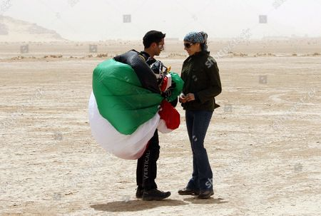 Stock Photo of Jordanian Prince Hamza Bin Al-hussein (l) Former Crown Prince and Half-brother of Jordan King Abdullah Ii is Seen After a Parachute Jump at Wadi Rum Desert South of Jordan 19 April 2011 Under the Patronage of Prince Hamzah the Royal Aero Sports Club of Jordan (rascj) Has Recently Announced Its Partnership with Skydive Dubai to Launch the Sport of Skydiving in Jordan This Summer the Announcement Took Place in Wadi Rum with the Presence of Jordanian and Regional Media Representatives During the Event It was Announced That Skydive Jordan Would Start Its Operations on 08 June Jordan Wadi Rum