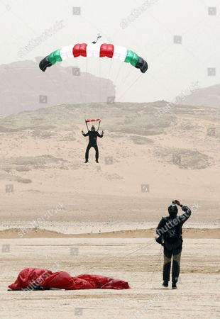 Stock Picture of Jordanian Prince Hamza Bin Al-hussein (top) Former Crown Prince and Half-brother of Jordan King Abdullah Ii Prepares to Land with His Parachute at Wadi Rum Desert South of Jordan 19 April 2011 Under the Patronage of Prince Hamzah the Royal Aero Sports Club of Jordan (rascj) Has Recently Announced Its Partnership with Skydive Dubai to Launch the Sport of Skydiving in Jordan This Summer the Announcement Took Place in Wadi Rum with the Presence of Jordanian and Regional Media Representatives During the Event It was Announced That Skydive Jordan Would Start Its Operations on 08 June Jordan Wadi Rum