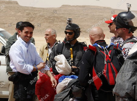 Stock Picture of Jordanian Prince Hamza Bin Al-hussein (l) Former Crown Prince and Half-brother of Jordan King Abdullah Ii is Seen After a Parachute Jump at Wadi Rum Desert South of Jordan 19 April 2011 Under the Patronage of Prince Hamzah the Royal Aero Sports Club of Jordan (rascj) Has Recently Announced Its Partnership with Skydive Dubai to Launch the Sport of Skydiving in Jordan This Summer the Announcement Took Place in Wadi Rum with the Presence of Jordanian and Regional Media Representatives During the Event It was Announced That Skydive Jordan Would Start Its Operations on 08 June Jordan Wadi Rum