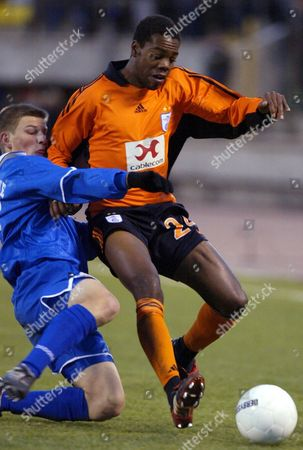 St Petersburg Russian Federation : Russian Andrey Arshavin (l) of Zenit Fights For a Ball with Swiss Jaggy Kim (r) of Grasshoppers Zurich During Their Uefa Cup Match in St Petersburg 03 October 2002
