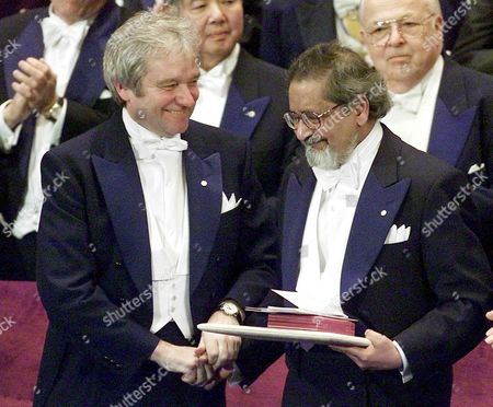 Stockholm Sweden : Britains Sir Paul Nurse (l) Shakes the Hand of Sir Vidiadhar Surajprasad Naipaul After He Received the Nobel Prize in Literature From the King of Sweden on Monday 10 December 2001 at the Concert Hall in Stockholm Naipaul who was Born in Trinidad and Resides in Britain Accepted the Prize in the Nobel 100th Anniversary Year