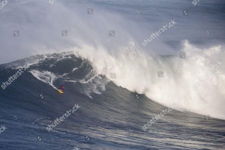 Kai Lenny performs during a big wave surfing session at Praia do Norte