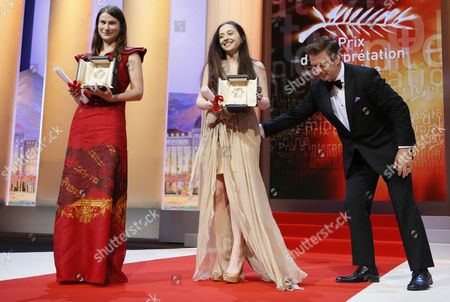 Stock Image of Actresses Cosmina Stratan (c) and Valeriu Andriuta (l) Receive the Best Performance by an Actress Awards For 'Dupa Dealuri' (beyond the Hills) From Us Actor Alec Baldwin (r) During the Closing Award Ceremony of the 65th Cannes Film Festival in Cannes France 27 May 2012 the Award Ceremony is Followed by the Screening of 'Therese Desqueyroux' Presented out of Competition France Cannes