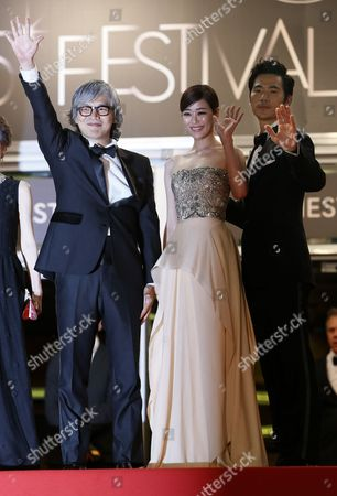 (l-r) South Korean Director Im Sang-soo South Korean Actress Kim Hyo-jin and South Korean Actor Kim Kang-woo Arrive For the Screening of 'Do-nui Mat' (the Taste of Money) During the 65th Cannes Film Festival in Cannes France 26 May 2012 the Movie is Presented in the Official Competition of the Festival Which Runs From 16 to 27 May France Cannes