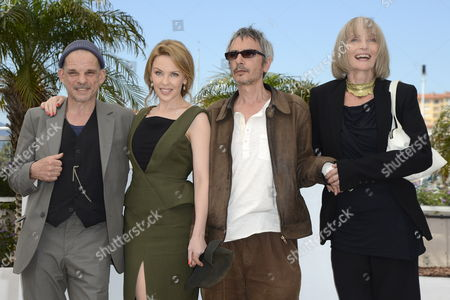 (l-r) French Actor Denis Lavant Australian Singer Kylie Minogue French-born Director Leos Carax and French Actress Edith Scob Pose During the Photocall For 'Holy Motors' at the 65th Cannes Film Festival in Cannes France 23 May 2012 the Movie is Presented in the Official Competition of the Festival Which Runs From 16 to 27 May France Cannes