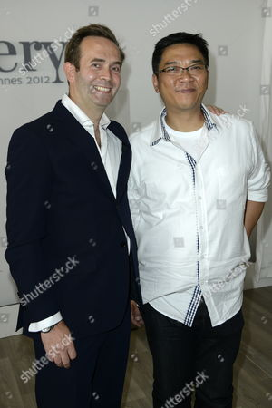 Louis Xiii Global Brand Director Augustin Depardon (l) and Hong Kong Director Stanley Kwan (r) Pose For Photographs Before the Conference 'East Meets West' Held at the Majestic Hotel Beach During the 65th Cannes Film Festival in Cannes France 23 May 2012 the Festival Runs From 16 to 27 May France Cannes