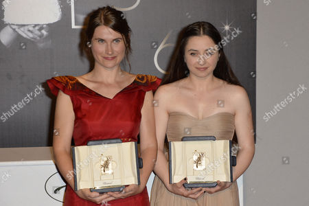 Stock Picture of Actresses Cosmina Stratan (r) and Valeriu Andriuta (l) Pose with the Best Performance by an Actress Awards For 'Dupa Dealuri' (beyond the Hills) During the Award Winners Photocall on the Closing Night of the 65th Cannes Film Festival in Cannes France 27 May 2012 France Cannes