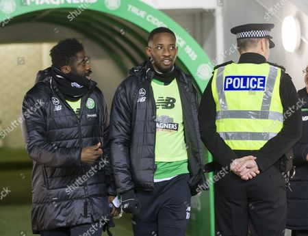 Kolo Toure & Moussa Dembele of Celtic  walk past a police officer before kick-off in the SPFL Ladbrokes Premiership match between Celtic & Ross County played at Celtic Park, Glasgow on 28th December