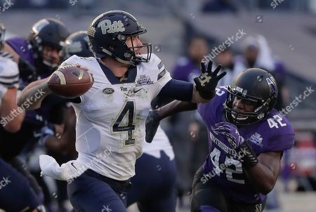 Pittsburgh quarterback Nathan Peterman (4) throws under pressure from Northwestern linebacker Joseph Jones (42) during the first quarter of the Pinstripe Bowl NCAA college football game, in New York