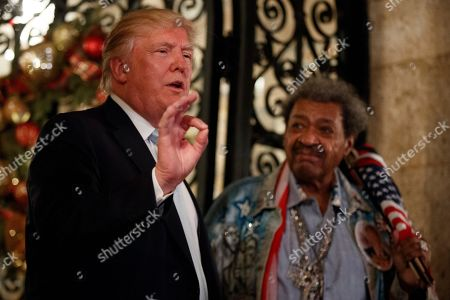 Donald Trump, Don King President-elect Donald Trump, left, stands with boxing promoter Don King as he speaks to reporters at Mar-a-Lago, in Palm Beach, Fla