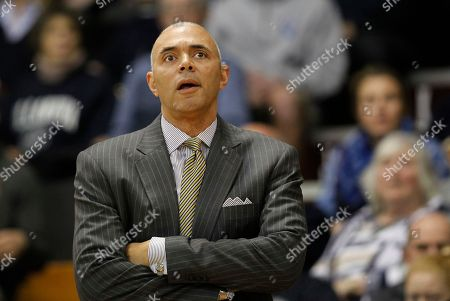 DePaul coach Rick Carter watches from the sideline during the first half of the team's NCAA college basketball game against Villanova, in Villanova, Pa
