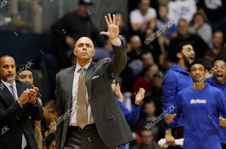 DePaul head coach Rick Carter shouts from the sidelines during an NCAA college basketball game against Villanova, in Villanova, Pa