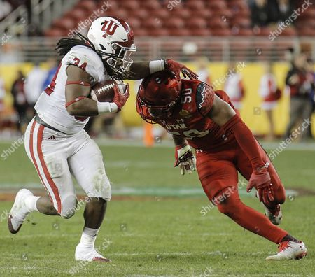 Santa Clara, CA, USA : Indiana running back Devine Redding (34) game stats 17 carriers for 72 and 1 touchdown during the NCAA Foster Farms Bowl football game between Indiana Hoosiers and the Utah Utes 24-26 lost at Levi Stadium Santa Clara Calif. Thurman James / CSM