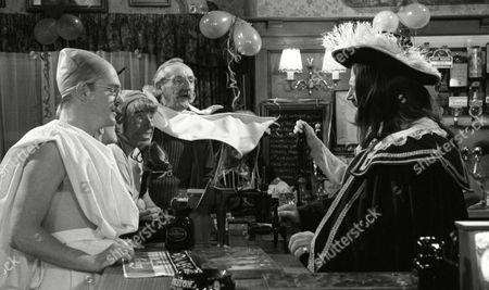 Stock Image of Tony Pitts (as Archie Brooks, dressed as Ghandi) and Johnny Caesar (as Bill Middleton) and Stan Richards (as Seth Armstrong) dressed as the Wright Brothers, with Richard Thorp (as Alan Turner, dressed as Charles II) to celebrate 1st Anniversary of Alan Turner running The Woolpack Pub (Episode 1630 - 30th January 1992)
