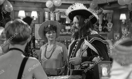 Philomena McDonagh (as Carol Nelson) and Richard Thorp (as Alan Turner, dressed as Charles II) in fancy dress to celebrate 1st Anniversary of Alan Turner running The Woolpack Pub (Episode 1630 - 30th January 1992)