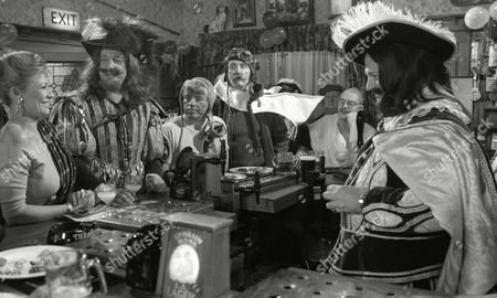 Johnny Caesar (as Bill Middleton) and Stan Richards (as Seth Armstrong) dressed as the Wright Brothers, with Norman Bowler (as Frank Tate, dressed as Charles I), Claire King (as Kim Tate, dressed in Indian costume) and Richard Thorp (as Alan Turner, dressed as Charles II) to celebrate 1st Anniversary of Alan Turner running The Woolpack Pub (Episode 1630 - 30th January 1992)