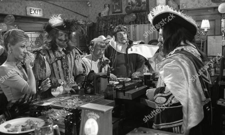 Stock Photo of Johnny Caesar (as Bill Middleton) and Stan Richards (as Seth Armstrong) dressed as the Wright Brothers, with Norman Bowler (as Frank Tate, dressed as Charles I), Claire King (as Kim Tate, dressed in Indian costume) and Richard Thorp (as Alan Turner, dressed as Charles II) to celebrate 1st Anniversary of Alan Turner running The Woolpack Pub (Episode 1630 - 30th January 1992)