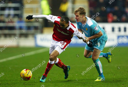 Peter Odemwingie of Rotherham United and Damien McCrory of Burton Albion during the Sky Bet Championship match between Rotherham United and Burton Albion played at the AESSEAL New York Stadium, Rotherham on 29th December 2016
