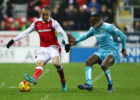 Peter Odemwingie of Rotherham United and Lloyd Dyer of Burton Albion during the Sky Bet Championship match between Rotherham United and Burton Albion played at the AESSEAL New York Stadium, Rotherham on 29th December 2016