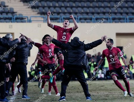Saad Samir, centre, celebrates after Moamen Zakaria, not pictured, scored for Al Ahly soccer team against Zamalek, during their Egyptian Premier League soccer match, at the Petro Sport Stadium in Cairo, Egypt