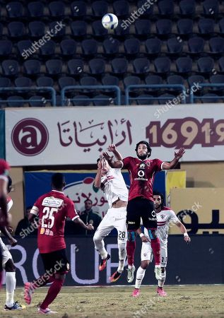 Mahmoud Hamdy from Zamalek, centre left, jumps for a high ball under pressure by Zamalek players, during their Egyptian Premier League soccer match at the Petro Sport Stadium in Cairo, Egypt