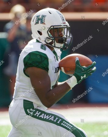Hawaii running back Paul Harris (6) returns the opening kickoff during the first quarter of an NCAA college football game at the Hawaii Bowl against Middle Tennessee, in Honolulu