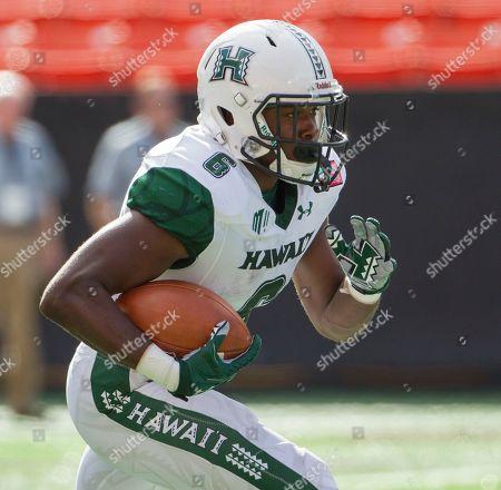 Stock Picture of Hawaii running back Paul Harris (6) returns the opening kickoff during the first quarter of an NCAA college football game at the Hawaii Bowl against Middle Tennessee, in Honolulu