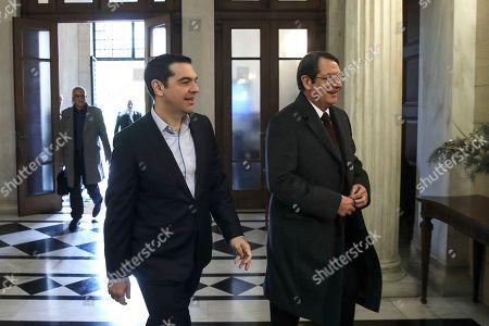 Nicos Anastasiadis, Alexis Tsipras Greece's Prime Minister Alexis Tsipras, left, escorts Cypriot President Nicos Anastasiadis ahead of their meeting in Athens,. Anastasiadis is on a one-day working visit to Greece
