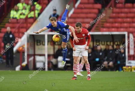 Birmingham's Jonathan Spector takes a dive over Sam Winnall's shoulders.  
