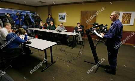 Capt. Michael Mullen of the U.S. Coast Guard answers questions during a news conference at Burke Lakefront Airport, in Cleveland. The U.S. Coast Guard says there's been no sign of debris or those aboard a plane that took off from the airport on the shores of Lake Erie and went missing overnight