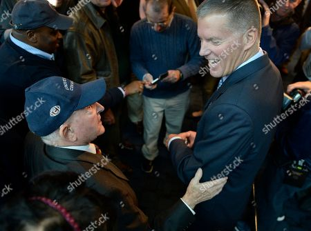 Randy Edsall, Milton Porter Newly announced Connecticut football head coach Randy Edsall talks with fan Milton Porter of Hebron, Conn., left, after a news conference to announce his return as coach at Pratt & Whitney Stadium at Rentschler Field, in East Hartford, Conn
