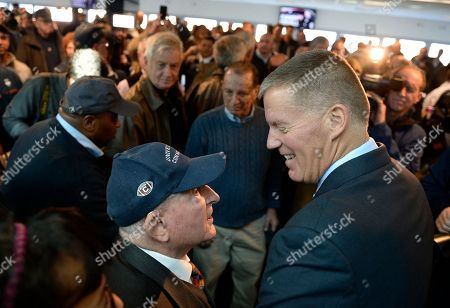 Randy Edsall, Milton Porter Newly announced Connecticut football head coach Randy Edsall talks with fan Milton Porter of Hebron, Conn., left, after an NCAA college football news conference at Pratt & Whitney Stadium at Rentschler Field, in East Hartford, Conn. Edsall, the most successful coach in UConn football history, is returning to the Huskies to try and right the ship one more time