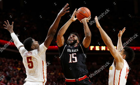 Aaron Ross, Merrill Holden, Naz Mitrou-Long Texas Tech forward Aaron Ross (15) drives to the basket between Iowa State's Merrill Holden, left, and Naz Mitrou-Long, right, during the first half of an NCAA college basketball game, in Ames, Iowa