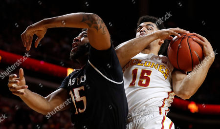 Naz Mitrou-Long, Aaron Ross Iowa State guard Naz Mitrou-Long, right, grabs a rebound over Texas Tech forward Aaron Ross during the first half of an NCAA college basketball game, in Ames, Iowa