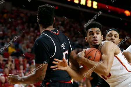 Naz Mitrou-Long, Aaron Ross Iowa State guard Naz Mitrou-Long, center, grabs a rebound in front of Texas Tech forward Aaron Ross, left, during the first half of an NCAA college basketball game, in Ames, Iowa