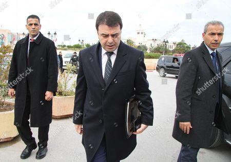 Tunisian Interior Minister Hedi Majdoub (C)