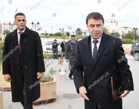 Tunisian Interior Minister Hedi Majdoub (R)