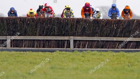 The field approach the water jump during The Betfred Follow The Action On Twitter Novices Limited Handicap Chase win by BELAMI DES PICTONS (yellow, Liam Treadwell) Newbury