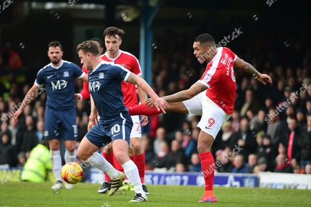 Charlton Athletic striker Josh Magennis (9) clears from Southend United striker Simon Cox (10) during the EFL Sky Bet League 1 match between Southend United and Charlton Athletic at Roots Hall, Southend