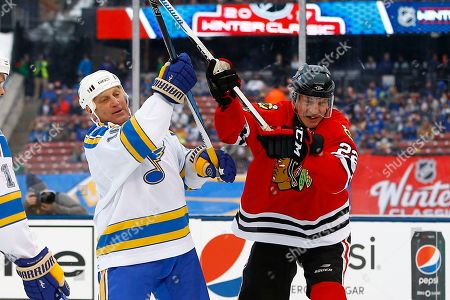 Brett Hull, Grant Mulvey Former St. Louis Blues' Brett Hull, left, and former Chicago Blackhawks' Grant Mulvey battle for position in front of the net during the winter classic alumni outdoor hockey game at Busch Stadium, in St. Louis