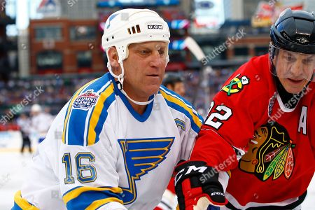 Brett Hull, Grant Mulvey Former St. Louis Blues' Brett Hull, left, battles along the board with former Chicago Blackhawks' Grant Mulvey during the winter classic alumni outdoor hockey game at Busch Stadium, in St. Louis