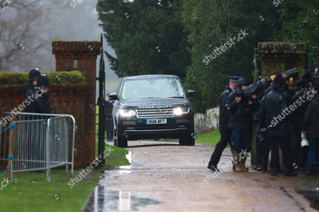 A Rover Range Rover carrying Prince Philip drives through the gates after members of the royal family attended the St. Mary Magdalene Church Sunday morning service