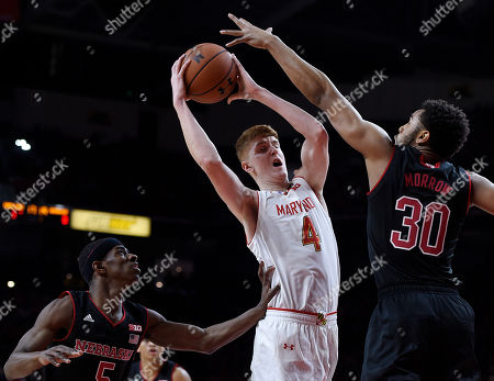 Kevin Huerter, Ed Morrow, Glynn Watson Jr Maryland's Kevin Huerter, center, shoots as Nebraska's Ed Morrow, right, defends during the first half of an NCAA college basketball game, in College Park, Md. Nebraska's Glynn Watson Jr, left, looks on