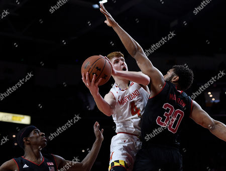 Kevin Huerter, Ed Morrow, Glynn Watson Maryland's Kevin Huerter, center, shoots as Nebraska's Ed Morrow, right, defends during the first half of an NCAA college basketball game, in College Park, Md. Nebraska's Glynn Watson Jr., left, looks on